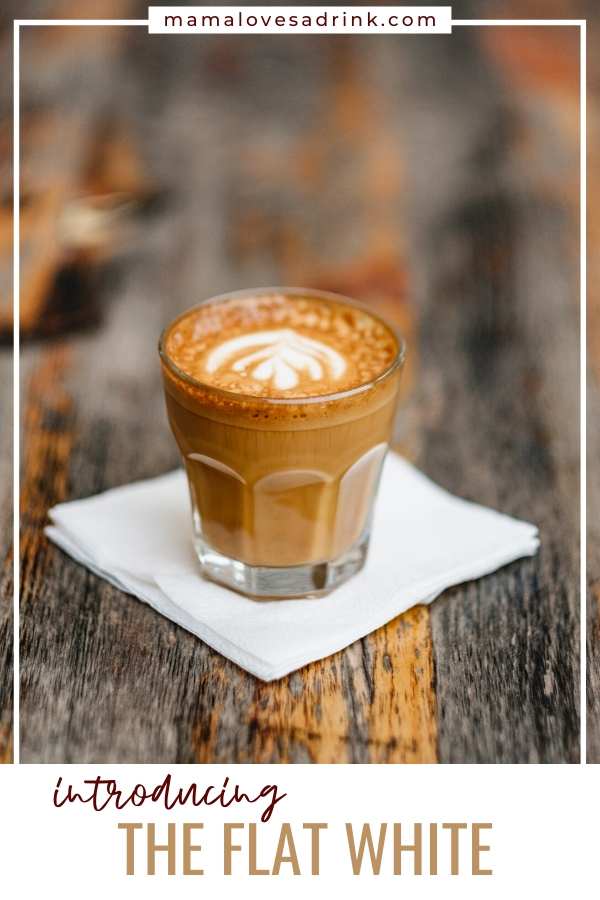 A glass of flat white coffee sitting on a napkin on a wooden table, captioned Introduction to flat white