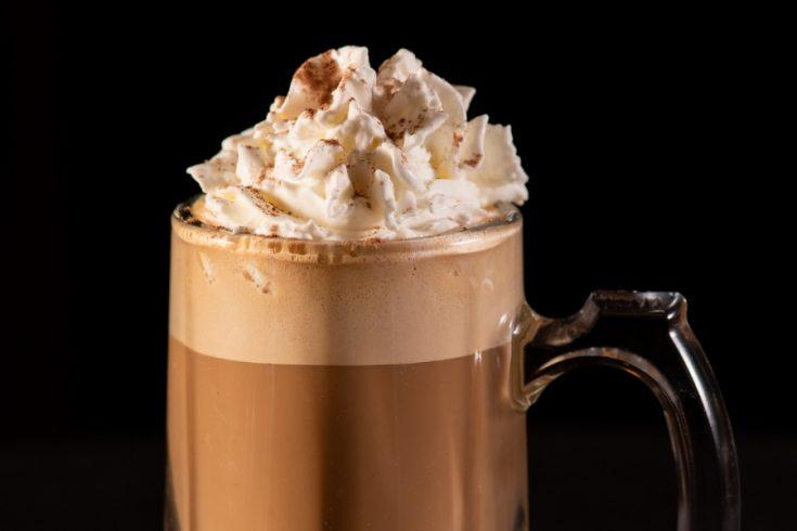 whipped cream on top of an irish coffee