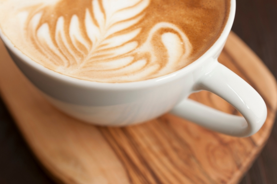 A beautifully served Flat White in a ceramic cup looks very similar to a Latte