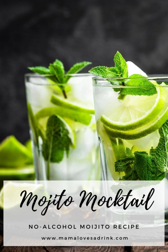 tall glass with transparent liquid, lime and fresh mint leaves