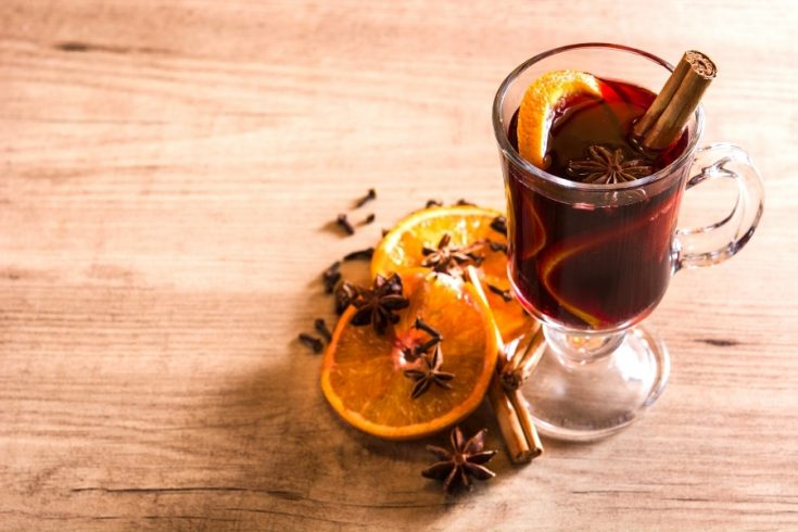 Mulled wine in tall glass with orange slices made in the thermomix