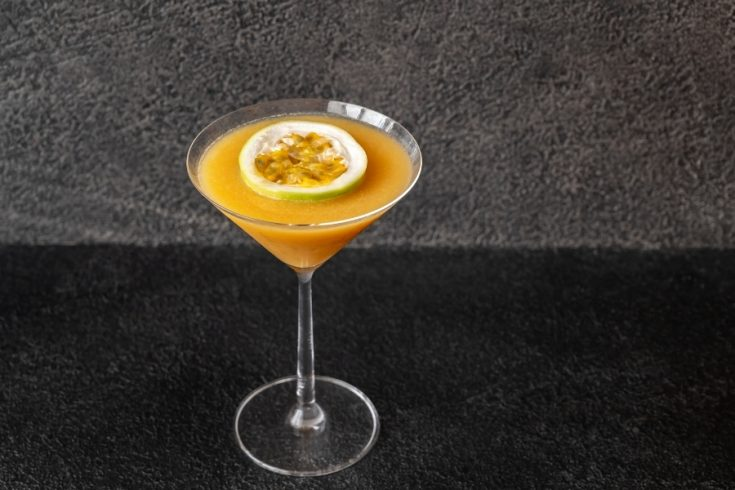Passionfruit - Porn Star Martini - Cocktail - glass of orange colored drink