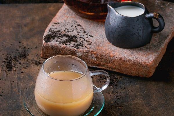 Hokkaido milk tea cup with milk jug in the background