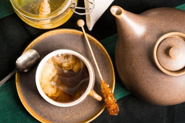 Cup of Okinawa milk tea with brown sugar stick