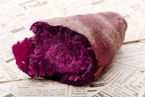 purple yam places on newspaper