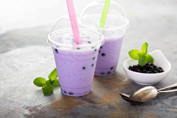 ube milk tea with straw